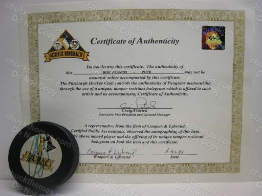 Ron Francis Signed Puck with a Penguins Certificate of Authenticity